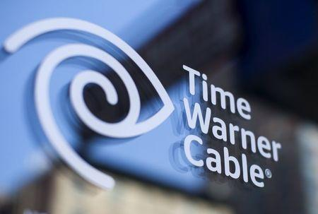 A Time Warner Cable sign and logo are seen on a Time Warner Cable store in the Manhattan borough of New York City