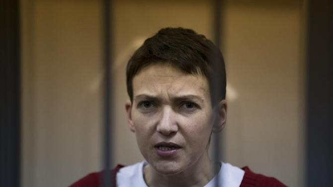 Ukrainian jailed military officer Nadezhda Savchenko listens to the court's decision in a cage at a court room in Moscow, Russia, Wednesday, March 4, 2015. A Russian court has rejected an appeal to release a Ukrainian military officer who has been on hunger strike since mid-December. The case of Nadezhda Savchenko has attracted high attention in recent weeks as concerns rise about her health. who has been on hunger strike since mid-December. The case of Nadezhda Savchenko has attracted high attention in recent weeks as concerns rise about her health. (AP Photo/Pavel Golovkin)