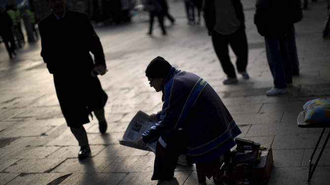 Spain pays mostly lower rates in debt sales