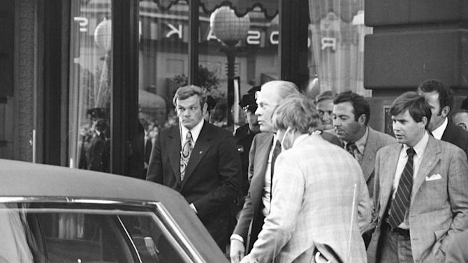 FILE - In this Sept. 22, 1975 file photo, a Secret Service agent, left, looks to the left after a shot was fired at President Gerald Ford as he leaves the St. Francis Hotel in San Francisco. The Secret Service has been tarnished by a prostitution scandal that erupted April 13, 2012 in Colombia involving 12 Secret Service agents, officers and supervisors and 12 more enlisted military personnel ahead of President Barack Obama's visit there for the Summit of the Americas. (AP Photo)