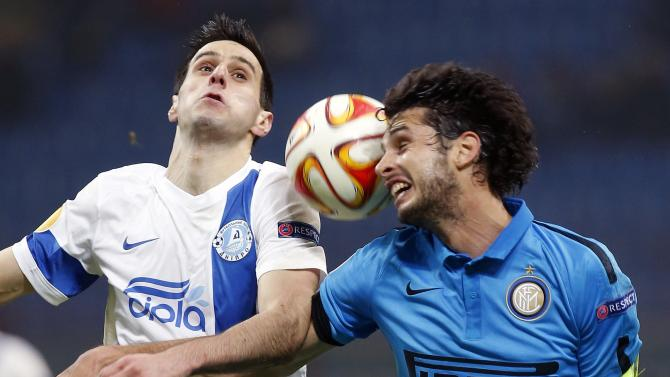 Inter Milan's Ranocchia fights for the ball with Dnipro Dnipropetrovsk's Kalinic during their Europa League Group F soccer match in Milan