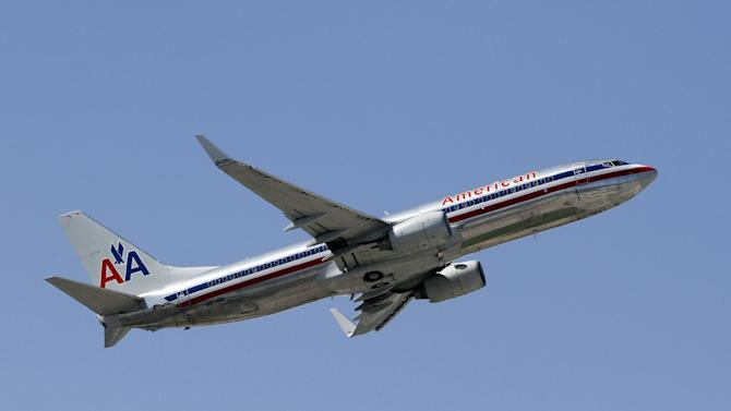 This Monday, Aug. 20, 2012, photo shows an American Airlines aircraft taking off at Miami International Airport in Miami. Just weeks ago, American Airlines was working its way through bankruptcy court, on schedule for one of the fastest turnarounds in aviation history, but then, domestic traffic fell by 7.1 percent in September from the same month a year earlier. No other major airline experienced a drop like that. (AP Photo/Alan Diaz)