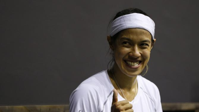 Malaysia's David celebrates after winning their women's single squash match final against her compatriot Low at the Yeorumul Squash Courts during the 17th Asian Games in Incheon