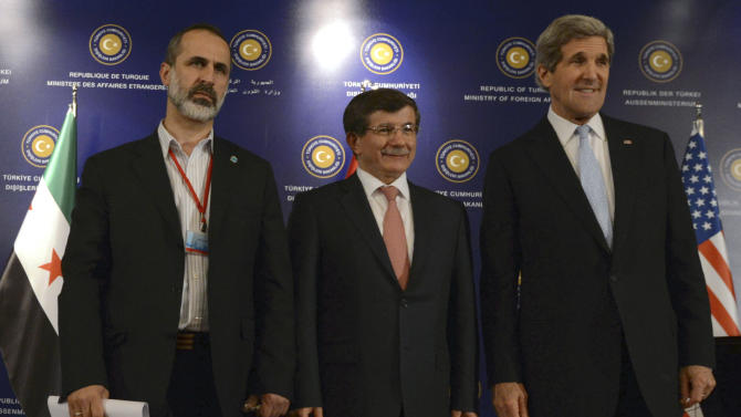 "U.S. Secretary of State John Kerry, right,  Turkish Foreign Minister Ahmet Davutoglu, center, and Syrian opposition leader Moaz al-Khatib pose for photos after a ""Friends of Syria"" group meeting at the Adile Sultan Palace on Sunday, April 21, 2013, in Istanbul, Turkey. The United States said Sunday that it will double its non-lethal assistance to Syria's opposition as the rebels' top supporters vowed to enhance and expand their backing of the two-year battle to oust President Bashar Assad's regime.  (AP Photo)"