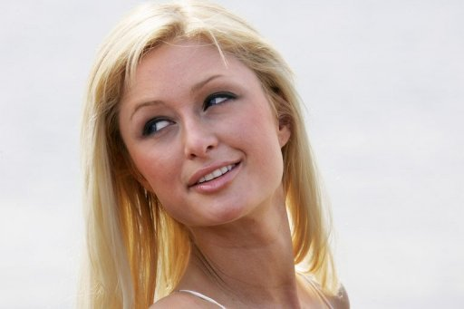 <p>US model and actress Paris Hilton poses for photographers after arriving at the Carlton hotel in Cannes in 2005. The US socialite will be the only Paris Hilton left after the hotel chain lost the right to manage its sole establishment in the centre of the French capital under a court ruling seen by AFP Monday.</p>