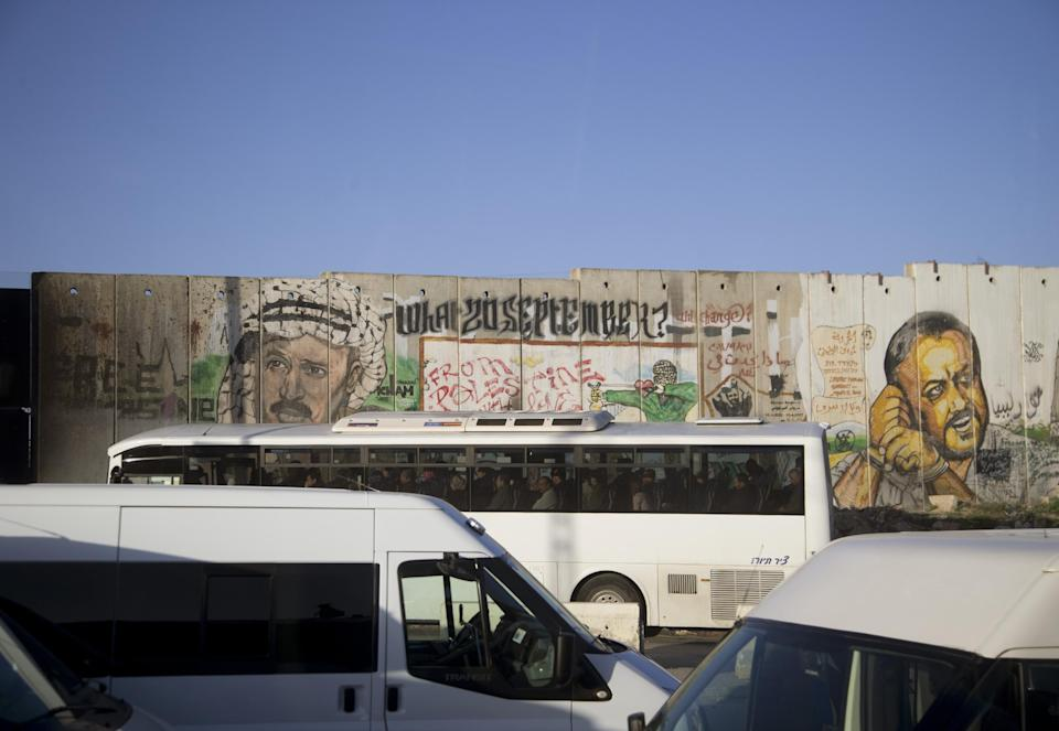 Traffic is at a standstill near a section of Israel's separation barrier near a crossing checkpoint Thursday, March 21, 2013, in the West Bank town of Ramallah. President Barack Obama is traveling to Ramallah to meet with Palestinian President Mahmoud Abbas. (AP Photo/Carolyn Kaster)