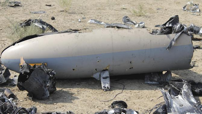 This undated photo released Monday, Aug. 25, 2014 by the Iranian Revolutionary Guards, claims to show the wreckage of an Israeli drone which Iran claims it shot down near an Iranian nuclear site. Iran's state TV on Monday broadcast footage purported to show an Israeli drone the country's Revolutionary Guard claimed to have shot down over the weekend near an Iranian nuclear site. The brief video, aired on the Arabic-language Al-Alam TV, shows what the channel says are parts of the drone, scattered in an unidentified desert area. (AP Photo/Sepahnews)