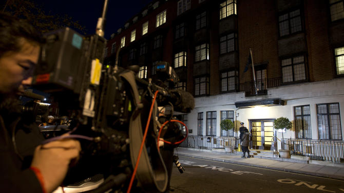 """Members of the media position themselves, as a policeman stands guard outside the King Edward VII hospital where the Duchess of Cambridge has been admitted with a severe form of morning sickness,  in London, Monday, Dec.  3, 2012. Prince William and his wife Kate are expecting their first child. St. James's Palace announced the pregnancy Monday, saying that the Duchess of Cambridge — formerly known as Kate Middleton — has a severe form of morning sickness and is currently in a London hospital. William is at his wife's side. The palace said since the pregnancy is in its """"very early stages,"""" the 30-year-old duchess is expected to stay in the hospital for several days and will require a period of rest afterward. (AP Photo/Alastair Grant)"""
