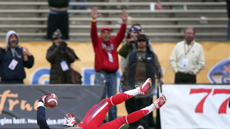 Arizona's Terrance Miller comes down with a touchdown catch in the end zone in front of Nevada's Bryson Keeton to tie the game in the closing seconds of the fourth quarter of New Mexico Bowl NCAA college football game in Albuquerque, N.M., Saturday, Dec. 15, 2012. Arizona won 49-48. (AP Photo/Eric Draper)