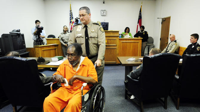 Frank Louis Reeves is wheeled out of the courtroom after his first appearance Tuesday Dec. 4, 2012, in Macon Ga. No bond was set Wednesday afternoon, Dec. 5, 2012, for Reeves who is accused in the death of a woman outside a Gray Highway gas station after his motorized wheelchair bumped her car. (AP Photo/The Macon Telegraph, Woody Marshall)