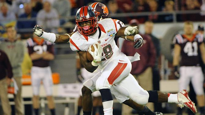 Rutgers running back Savon Huggins (28) runs for a gain of 11 yards in front of Virginia Tech's Detrick Bonner during the first quarter of an NCAA college football Russell Athletic Bowl game on Friday, Dec. 28, 2012, in Orlando, Fla. (AP Photo/Brian Blanco)