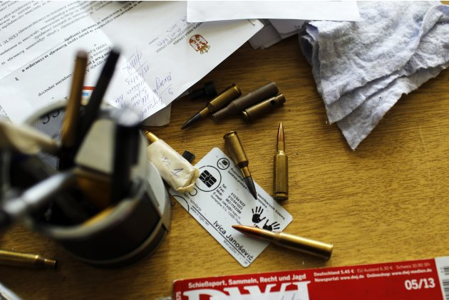 "Bullets are seen on the table of a weapons designer at the manufacturing hall in the ""Zastava Arms"" weapons factory in the Serbian town of Kragujevac"