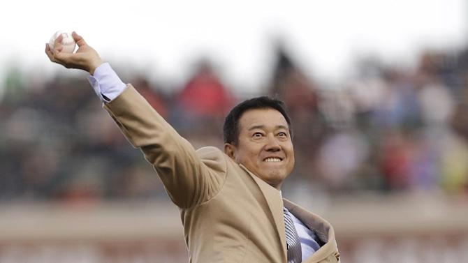 Former baseball player Tatsunori Hara throws the ceremonial first pitch before a semifinal game of the World Baseball Classic between Japan and Puerto Rico in San Francisco, Sunday, March 17, 2013. (AP Photo/Ben Margot)