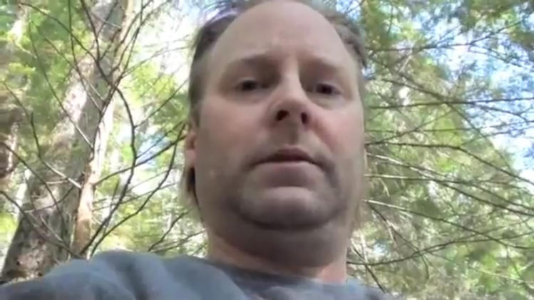 This image from video provided by the King County Sheriff's Office Thursday July 12, 2012 shows Peter Keller recording a video explaining why he killed his wife and daughter and retreated to a remote bunker in Washington's Cascade Mountains. He was bored. Keller shot his wife, Lynnettee, and his 18-year-old daughter, Kaylene, at their home in North Bend, east of Seattle, in April.  (AP Photo/King County Sheriff's Office)