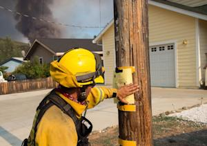 Firefighters post signs in the Spring Valley community…