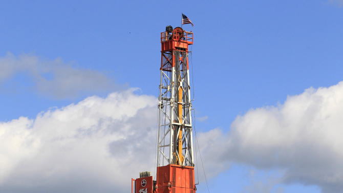 In this Wednesday, Sept. 19, 2012 photo, shows a drill rig in Carrollton, Ohio. Rural Carroll County boasts more active oil and gas wells than any other county in Ohio, and the tax dollars are flowing right along with the crude. (AP Photo/Tony Dejak)