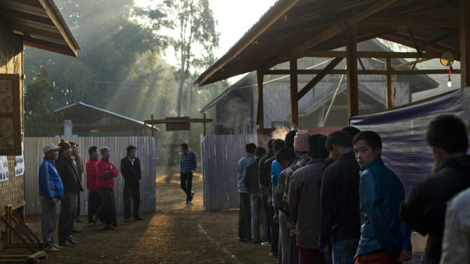 In this photo taken on Feb 12, 2013, camp residents stand in a line for breakfast as mentors watch at dawn at the Kachin Baptist Convention's rehabilitation camp in Myitkyina, the provincial capital of Kachin state, Myanmar. Myitkyina is known for having one of the highest concentrations of drug addicts in the world. The Kachin Baptist Convention, an evangelical group with over 300 churches in the state, says nearly 80 percent of ethnic Kachin youth are addicts. Their drug of choice is heroin. In the shadow of war, even drug abuse becomes politicized. Gryung Heang, the pastor of the camp church, says the government is willfully turning a blind eye to drug abuse among the Kachin because it wants to decimate young potential fighters. Officials say such views are absurd.(AP Photo/Gemunu Amarasinghe)