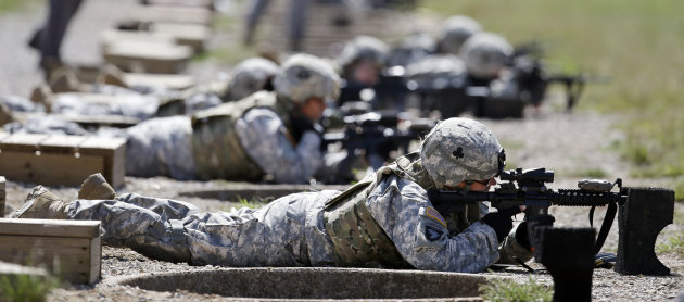 Female soldiers train on a firing range while wearing new body armor on Tuesday, Sept. 18, 2012, in Fort Campbell, Ky. Female soldiers from 1st Brigade Combat Team, 101st Airborne Division are field testing the first Army body armor designed to fit women's physiques in preparation for their deployment to Afghanistan this fall. (AP Photo/Mark Humphrey).