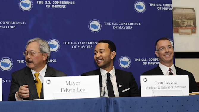 From left to right, Edwin Lee, mayor of San Francisco, musician John Legend; Craig Hagen, Senior Director of Government Affairs at Electronic Arts, Inc. listen during a panel on STEM education and the announcement of SimCity EDU by EA Maxis at the National Conference of Mayors, Friday, Jan. 18, 2013, in Washington. (Photo/Nick Wass/Invision for EA)