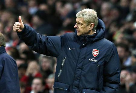 Arsenal manager Wenger reacts during their English Premier League match against Fulham at the Emirates stadium in London