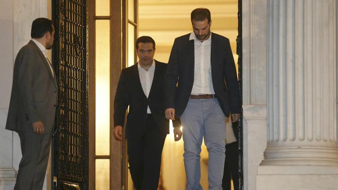 Greek Prime Minister Tspiras leaves his offices after referendum results in Athens