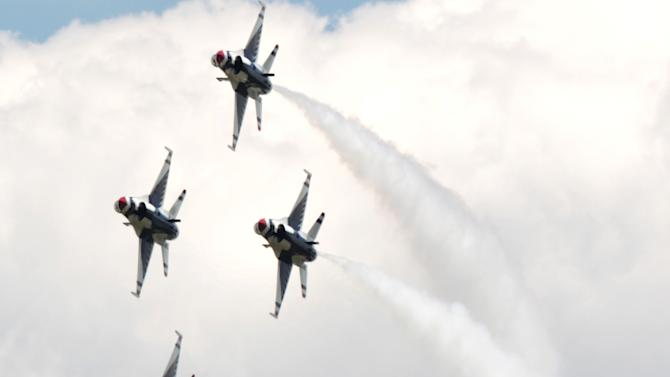 In this June 22, 2012, photo the United States Air Force Thunderbirds perform at the Indianapolis Air Show at the Indianapolis Regional Airport near Greenfield, Ind. The air show, canceled in February over concerns the Blue Angels wouldn't participate, is one of dozens that have been canceled this year after the military grounded its jet and demonstration teams because of automatic federal budget cuts. (AP Photo/The Indianapolis Star, Charlie Nye)  NO SALES