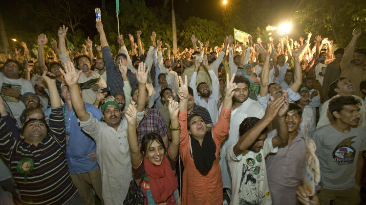 Supporters of Pakistan Muslim League-N party celebrate the primary unofficial results for the country's parliamentary elections at the party's headquarter in Lahore, Pakistan, Saturday, May 11, 2013. The Pakistan Muslim League-N party, led by two-time Prime Minister Nawaz Sharif, has long been considered the front-runner in the race. The party appeared to be moving toward a significant victory Saturday based on partial vote counts announced by Pakistan state TV. (AP Photo/Anjum Naveed)