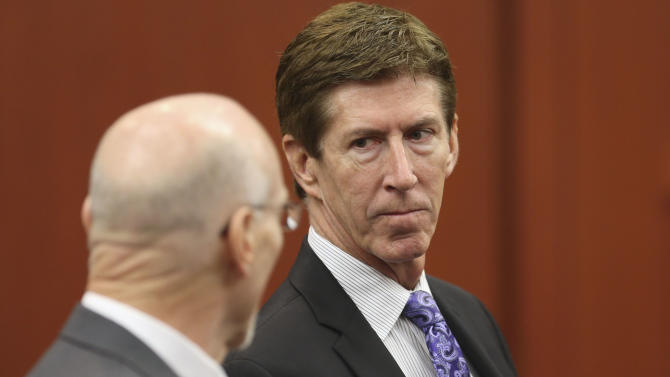 Defense attorneys Don West, left, and Mark O'Mara raise concerns with judge Debra Nelson before opening arguments during George Zimmerman's trial in Seminole circuit court in Sanford, Fla., Friday, June 21, 2013. Zimmerman has been charged with second-degree murder for the 2012 shooting death of Trayvon Martin. (AP Photo/Orlando Sentinel, Gary W. Green, Pool)