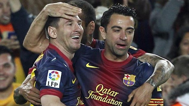 Barcelona's Lionel Messi (L) and Xavi Hernandez celebrate a goal against Real Betis (Reuters)