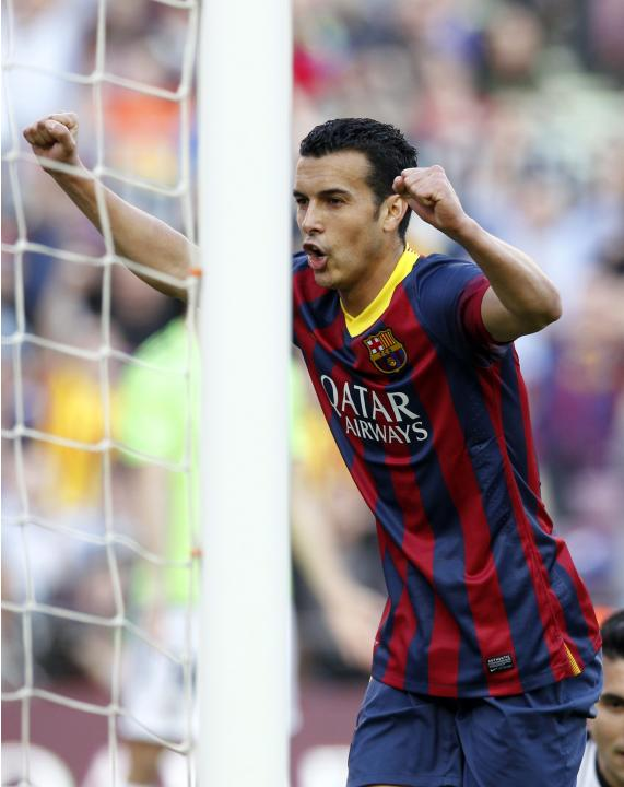 Barcelona's Pedro Rodriguez celebrates a goal against Osasuna during their Spanish first division soccer match at Camp Nou stadium in Barcelona