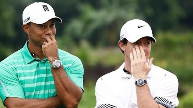 Tiger Woods of the United States with Rory McIlroy of Northern Ireland react at Blackstone Course Mission Hills on October 28, 2013 in Haikou, China.