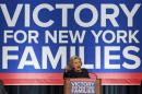 U.S. Democratic presidential candidate Clinton addresses at a rally to celebrate the state of New York passing into law a $15 minimum wage in New York
