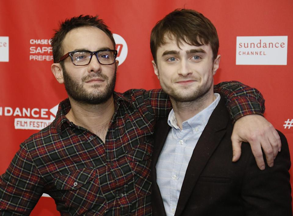 "Director John Krokidas, left, and actor Daniel Radcliffe pose at the premiere of ""Kill Your Darlings"" during the 2013 Sundance Film Festival on Friday, Jan. 18, 2013 in Park City, Utah. (Photo by Danny Moloshok/Invision/AP)"