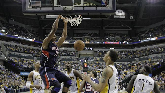 Atlanta Hawks' Al Horford (15) dunks during the first half of Game 1 in the first round of the NBA basketball playoffs against the Indiana Pacers, Sunday, April 21, 2013, in Indianapolis. (AP Photo/Darron Cummings)