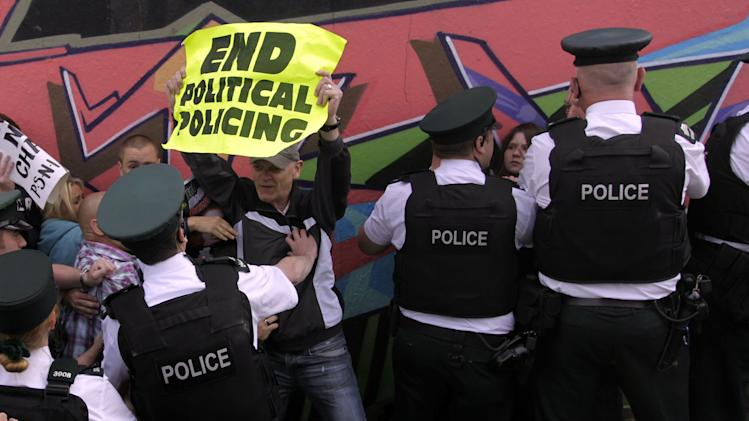 Irish Republican's clash with Police Service of Northern Ireland officers as they protest whilst the Olympic torch tries to pass in Londonderry, Northern Ireland, Monday, June 4, 2012. Dissident Republican protesters caused the Olympic torch to be rerouted Monday.  (AP Photo/Peter Morrison)