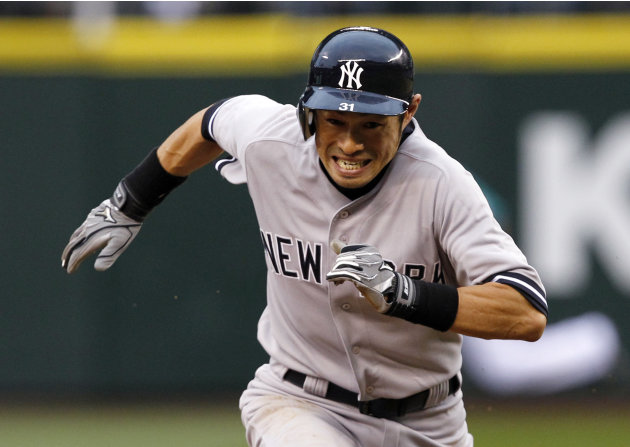 New York Yankees' Ichiro Suzuki races to third against the Seattle Mariners in the fourth inning of a baseball game Monday, July 23, 2012, in Seattle. (AP Photo/Elaine Thompson)