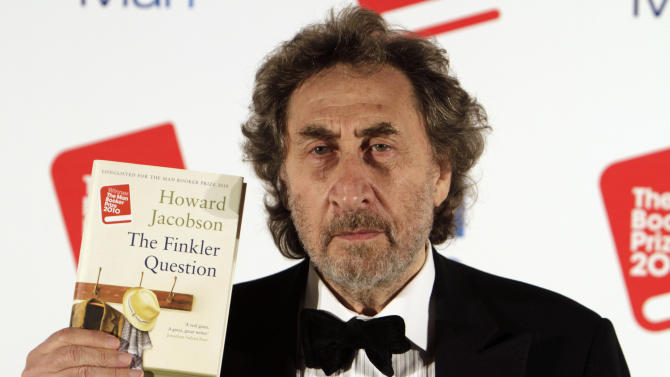 """FILE - In this Oct. 12, 2010 file photo, British author Howard Jacobson displays his book  """"The Finkler Question"""", winner of  the Man Booker Prize for Fiction 2010, following the announcement at central London's Guildhall, Britain. The Dalai Lama is set to headline India's Jaipur Literature Festival to speak about faith with one of his biographers, Pico Iyer. This year's festival will also feature author Zoe Heller and Booker Prize winner Howard Jacobson. (AP Photo/Lefteris Pitarakis, File)"""