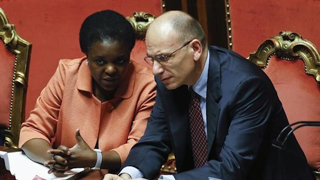 Italy's Prime Minister Enrico Letta (R) talks with Minister for integration Cecile Kyenge (Reuters)