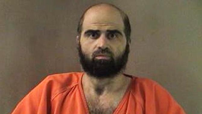 FILE - This undated file photo provided by the Bell County Sheriff's Department shows Maj. Nidal Hasan. The Army psychiatrist sentenced to death for the Fort Hood shooting rampage has been forcibly shaved according to a statement released by Fort Leavenworth on Tuesday, Sept. 3, 2013. Hasan began growing a beard in the years after the November 2009 shooting that left 13 dead and 30 wounded. The beard prompted delays to his court-martial because it violated Army grooming regulations. (AP Photo/Bell County Sheriff's Department, File)