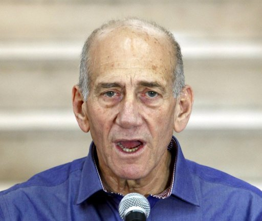 Former Israeli prime minister Ehud Olmert speaks to the press at the District Court in Jerusalem. An Israeli court has found Olmert guilty on one charge in a closely watched corruption case, but cleared him on two other charges, in a verdict he hailed as just. (AFP Photo/Gali Tibbon)