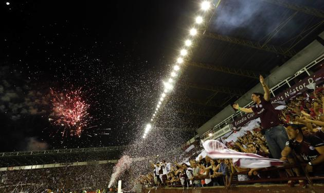 Fans of Argentina's Lanus cheer as fireworks explode before their Copa Sudamericana second leg final soccer match against Brazil's Ponte Preta in Buenos Aires
