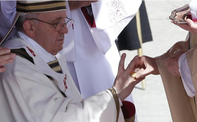 The Fisherman's Ring is placed on the finger of Pope Francis by Cardinal Angelo Sodano, Dean of the College of Cardinals during his inaugural mass at the Vatican