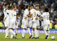 Real Madrid's Karim Benzema from France, third right, celebrates his goal with teammates during the Santiago Bernabeu Trophy soccer match against Galatasaray at the Santiago Bernabeu stadium in Madrid, Spain, Wednesday, Aug. 24, 2011. (AP Photo/Andres Kudacki)