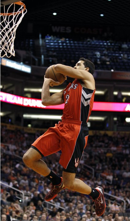 Toronto Raptors forward Landry Fields jumps to the basket on a break-away dunk against the Phoenix Suns during the second half of their NBA basketball game in Phoenix