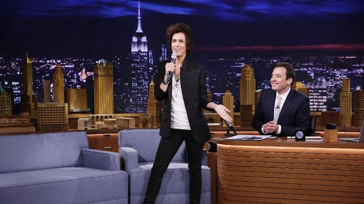 "This Tuesday, Feb. 18, 2014 photo released by NBC shows Kristen Wiig, left, with host Jimmy Fallon during ""The Tonight Show Starring Jimmy Fallon,"" in New York. (AP Photo/NBC, Lloyd Bishop)"