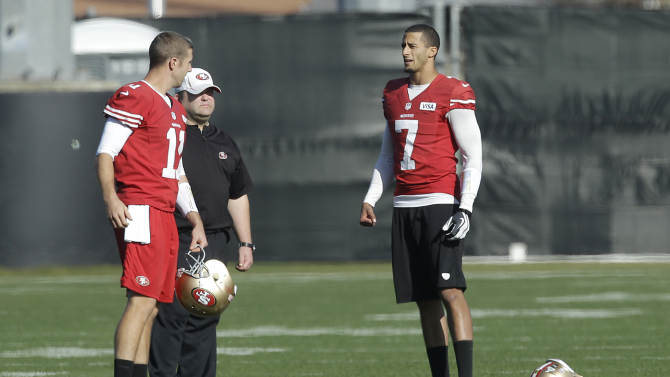 San Francisco 49ers quarterback Colin Kaepernick (7) talks with quarterback Alex Smith (11) and offensive coordinator Greg Roman during practice at an NFL football training facility in Santa Clara, Calif., Friday, Jan. 25, 2013. The 49ers are scheduled to play the Baltimore Ravens in the Super Bowl on Sunday, Feb. 3. (AP Photo/Jeff Chiu)