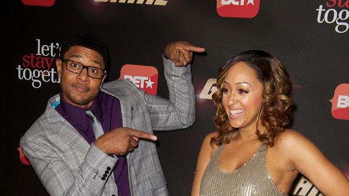 "Pooch Hall and Tia Mowry arrive at BET's ""The Game"" and ""Let's Stay Together"" premiere party at the Hollywood Roosevelt Hotel on January 5, 2012 in Hollywood, California."