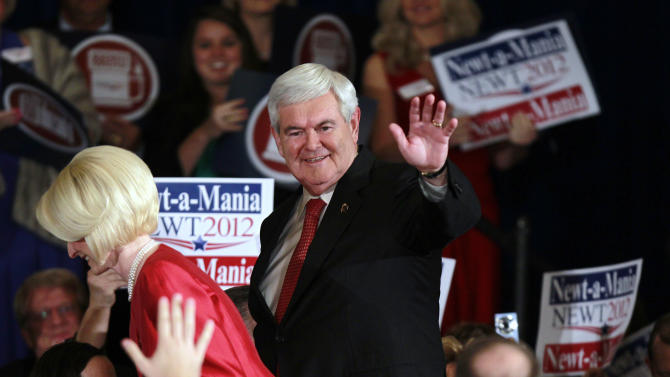 Republican presidential candidate former House Speaker Newt Gingrich and his wife Callista, left, wave to supporters before speaking to a crowd gathered for a rally after he won the Georgia primary Tuesday, March 6, 2012, in Atlanta. (AP Photo/John Bazemore)
