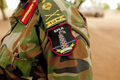 A Sudan People's Liberation Army (SPLA) commander dons the new insignia of the 4th Division petroleum defense unit in Bentiu, Unity State, South Sudan on Friday, May 11, 2012. In late April, tensions between Sudan&lt;br /&gt;&lt;br /&gt;&lt;br /&gt;&lt;br /&gt;&lt;br /&gt;&lt;br /&gt;&lt;br /&gt;&lt;br /&gt;&lt;br /&gt;<br />  and South Sudan erupted into armed conflict along their poorly defined border. Thousands of SPLA forces have been deployed to Unity State where the two armies are at a tense stalemate around the state's expansive oil fields. Fighting between the armies lulled in early May after the U.N. Security Council ordered the countries to resume negotiations. South Sudan seceded from the Republic of Sudan in July 2011 following decades of civil war. (AP Photo/Pete Muller)