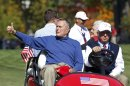 Former U.S. president H.W. Bush attends the afternoon four-ball round at the 39th Ryder Cup matches at the Medinah Country Club